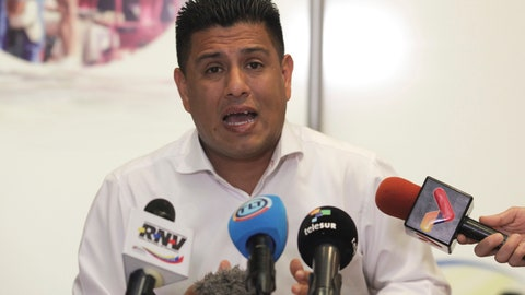 <p>               Venezuela Sports Minister Pedro Infante speaks during a news conference from his office in Caracas, Venezuela, Saturday, Jan. 26, 2019. Infante announced that Venezuela will go ahead with an upcoming international baseball tournament in Barquisimeto despite safety concerns stemming from anti-government unrest that has roiled the nation in the past week. (AP Photo/Boris Vergara)             </p>