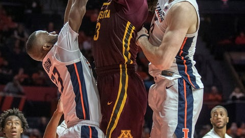 <p>               Minnesota forward Jordan Murphy (3) tries to shoot between Illinois guard Aaron Jordan, left, and forward Giorgi Bezhanishvili (15) during the second half of an NCAA college basketball game in Champaign, Ill., Wednesday, Jan. 16, 2019. (AP Photo/Rick Danzl)             </p>