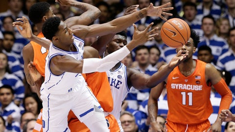<p>               Duke's RJ Barrett and Zion Williamson, rear, reach for a rebound with Syracuse's Oshae Brissett (11) and Frank Howard during the first half of an NCAA college basketball game in Durham, N.C., Monday, Jan. 14, 2019. (AP Photo/Gerry Broome)             </p>