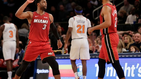 <p>               Miami Heat's Dwyane Wade, left, celebrates with Wayne Ellington after Ellington scored a three-point basket during the second half of the NBA basketball game, Sunday, Jan. 27, 2019, in New York. The Heat defeated the Knicks 106-97.(AP Photo/Seth Wenig)             </p>