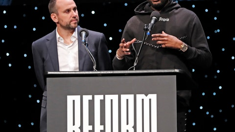 <p>               Philadelphia 76ers co-owner and Fanatics executive Michael Rubin, left, listens as recordng artist Meek Mill speaks at the launch of a partnership of sports, business and recording artists who hope to transform the American criminal justice system, Wednesday, Jan. 23, 2019, in New York. (AP Photo/Kathy Willens)             </p>