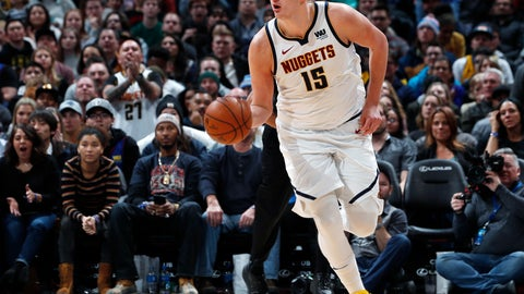 <p>               FILE - In this Tuesday, Jan. 1, 2019, file photo, Denver Nuggets center Nikola Jokic picks up a loose ball and heads down the court in the second half of an NBA basketball game against the New York Knicks in Denver. Jokic, a 7-footer from Serbia, is leading the Nuggets to new heights so far this season with his style of play in the pivot. (AP Photo/David Zalubowski, File)             </p>