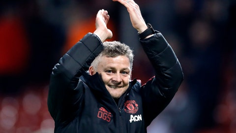 <p>               Manchester United interim manager Ole Gunnar Solskjaer celebrates defeating Huddersfield after the English Premier League soccer match  at Old Trafford, Manchester, England, Wednesday Dec. 26, 2018. (Martin Rickett/PA via AP)             </p>