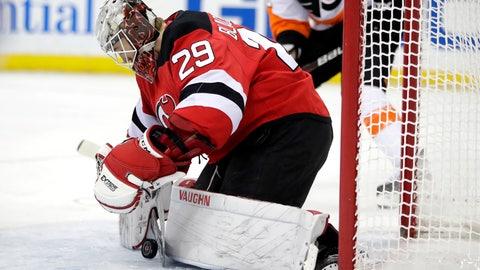 <p>               New Jersey Devils goaltender MacKenzie Blackwood blocks a shot from the Philadelphia Flyers during the first period of an NHL hockey game, Saturday, Jan. 12, 2019, in Newark, N.J. (AP Photo/Julio Cortez)             </p>