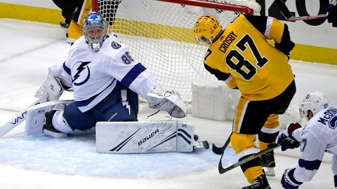 <p>               Pittsburgh Penguins' Sidney Crosby (87) puts the puck past Tampa Bay Lightning goaltender Andrei Vasilevskiy (88) for a goal in the first period of an NHL hockey game in Pittsburgh, Wednesday, Jan. 30, 2019. (AP Photo/Gene J. Puskar)             </p>