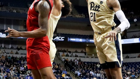 <p>               Pittsburgh's Trey McGowens (2) blocks a shot by Louisville's Malik Williams, left, in the first half of an NCAA college basketball game, Wednesday, Jan. 9, 2019, in Pittsburgh. (AP Photo/Keith Srakocic)             </p>