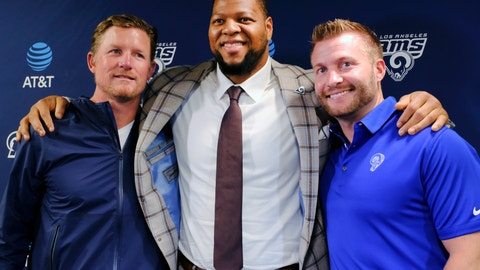 <p>               FILE - In this April 6, 2018, file photo, Los Angeles Rams new defensive tackle Ndamukong Suh, center, poses for a photo after a news conference with coach Sean McVay, right, and general manager Les Snead at the NFL football team's practice facility in Thousand Oaks, Calif. The excitement of the Rams' incredible one-season turnaround wasn't ruined by one defeat. Yet that loss was a signal to Snead, who decided it was time to do everything possible to help homegrown stars Todd Gurley, Aaron Donald and Jared Goff. So the Rams made several enormous bets on themselves, and every single one of them has paid off. (AP Photo/Richard Vogel, File)             </p>