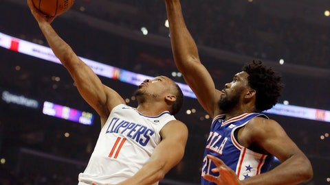 <p>               Los Angeles Clippers guard Avery Bradley, left, shoots while Philadelphia 76ers center Joel Embiid defends during the first half of an NBA basketball game in Los Angeles, Tuesday, Jan. 1, 2019. (AP Photo/Alex Gallardo)             </p>