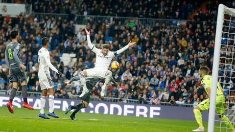 <p>               Real Madrid's Sergio Ramos jumps with Real Sociedad's Asier Illarramendi during a Spanish La Liga soccer match between Real Madrid and Real Sociedad at the Santiago Bernabeu stadium in Madrid, Spain, Sunday, Jan. 6, 2019. (AP Photo/Paul White)             </p>
