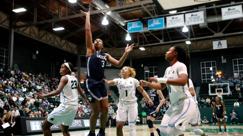 <p>               Connecticut guard Megan Walker (3) goes to the basket over Tulane guard Kaila Anderson (1), forward Krystal Freeman (23) and guard Tatyana Lofton (11) in the first half of an NCAA college basketball game in New Orleans, Wednesday, Jan. 16, 2019. (AP Photo/Gerald Herbert)             </p>