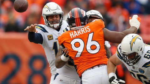 <p>               Los Angeles Chargers quarterback Philip Rivers, left, throws a pass under pressure from Denver Broncos defensive end Shelby Harris (96) during the first half of an NFL football game, Sunday, Dec. 30, 2018, in Denver. (AP Photo/David Zalubowski)             </p>