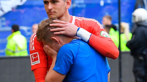 <p>               File--- Picture taken May 12, 2018 shows Hamburg's goalkeeper Julian Pollersbeck and Lewis Holtby after being relegated in Hamburg, Germany. (Marvin Ibo Güngör/dpa via AP)             </p>