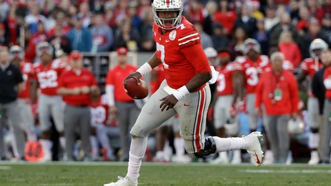 <p>               FILE - In this Jan. 1, 2019, file photo, Ohio State quarterback Dwayne Haskins runs against Washington during the first half of the Rose Bowl NCAA college football game, in Pasadena, Calif. Record-setting Ohio State quarterback Dwayne Haskins Jr. says he is leaving school to enter the NFL draft. The third-year sophomore announced Monday, Jan. 7, 2019,  on Twitter that he will depart the program after one year as a starter in which he broke most school and Big Ten single-season passing records. (AP Photo/Jae C. Hong, File)             </p>