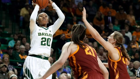 <p>               Baylor guard Juicy Landrum (20) shoots as Iowa State guard Bridget Carleton (21) and guard Ashley Joens, right, defend in the second half of an NCAA college basketball game in Waco, Texas, Wednesday, Jan. 23, 2019. (AP Photo/Tony Gutierrez)             </p>