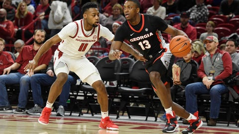 <p>               Georgia guard E'Torrion Wilridge (13) tries to get past Arkansas defender Keyshawn Embery-Simpson (11) during the first half of an NCAA college basketball game, Tuesday, Jan.29, 2019 in Fayetteville, Ark. (AP Photo/Michael Woods)             </p>
