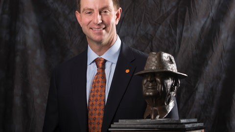 """<p>               Clemson coach Dabo Swinney poses for a photograph with the Paul """"Bear"""" Bryant Coach of the Year Award, before the ceremony Wednesday, Jan. 9, 2019, in Houston. (Yi-Chin Lee/Houston Chronicle via AP)             </p>"""