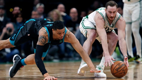 <p>               Charlotte Hornets forward Miles Bridges, left, dives as Boston Celtics forward Gordon Hayward, right, grabs a loose ball during the second half of an NBA basketball game in Boston, Wednesday, Jan. 30, 2019. The Celtics defeated the Hornets 126-94. (AP Photo/Charles Krupa)             </p>