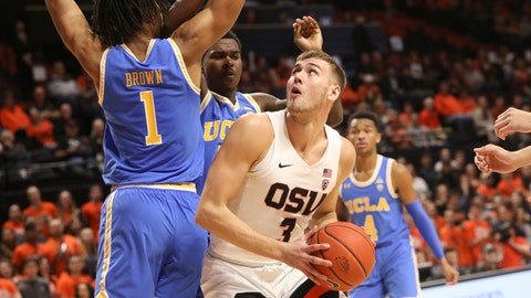 <p>               Oregon State's Tres Tinkle looks for a path to the basket past UCLA's Moses Brown during the first half of an NCAA college basketball game in Corvallis, Ore., Sunday, Jan. 13, 2019. (AP Photo/Amanda Loman)             </p>