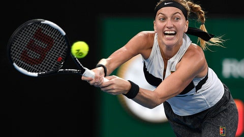 <p>               Petra Kvitova of the Czech Republic hits a backhand to Japan's Naomi Osaka during the women's singles final at the Australian Open tennis championships in Melbourne, Australia, Saturday, Jan. 26, 2019. (AP Photo/Andy Brownbill)             </p>