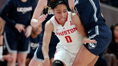<p>               Houston guard Angela Harris (0) is boxed in by Connecticut forward Napheesa Collier, right, and guard/forward Katie Lou Samuelson, back, during the first half of an NCAA college basketball game Sunday, Jan. 6, 2019, in Houston. (AP Photo/Michael Wyke)             </p>
