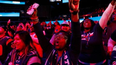 <p>               Fans cheer during Opening Night for the NFL Super Bowl 53 football game, Monday, Jan. 28, 2019, in Atlanta. (AP Photo/David Goldman)             </p>