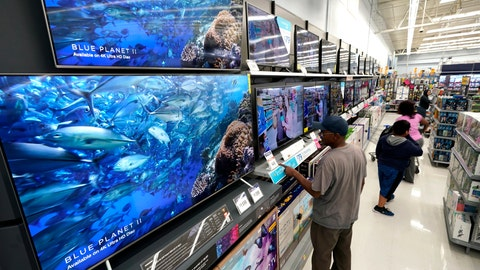 <p>               FILE- In this Nov. 9, 2018, file photo shoppers look at televisions at a Walmart Supercenter in Houston. Super Bowl season is an excellent time to purchase a new TV, as long as you have room in your home and budget. (AP Photo/David J. Phillip, File)             </p>