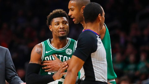 <p>               Boston Celtics guard Marcus Smart (36) is restrained by center Al Horford during the second half of the team's NBA basketball game against the Atlanta Hawks on Saturday, Jan. 19, 2019, in Atlanta. (AP Photo/Todd Kirkland)             </p>