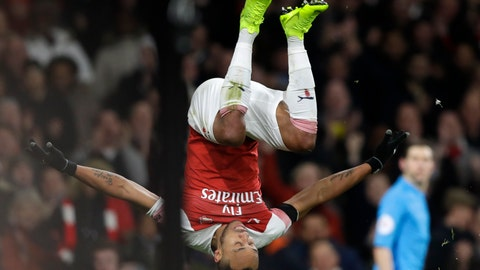 <p>               Arsenal's Pierre-Emerick Aubameyang celebrates after scoring his side's fourth goal during the English Premier League soccer match between Arsenal and Fulham at Emirates stadium in London, Tuesday, Jan. 1, 2019. (AP Photo/Kirsty Wigglesworth)             </p>