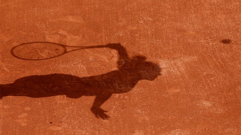 <p>               FILE - In this Tuesday, May 30, 2017 file photo a tennis player casts a shadow on the clay as they serve during a tennis match at the French Open tennis tournament at the Roland Garros stadium in Paris. Four people are in French custody on suspicion of fixing matches for an Armenian based in Belgium believed behind an illegal gambling syndicate suspected of fixing hundreds of matches. (AP Photo/Petr David Josek, File)             </p>