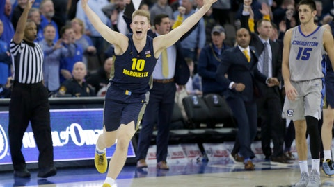 <p>               Creighton's Martin Krampelj (15) watches as Marquette's Sam Hauser (10) celebrates his 3-point game-tying basket at the buzzer during the second half of an NCAA college basketball game in Omaha, Neb., Wednesday, Jan. 9, 2019. Marquette won 106-104 in overtime. (AP Photo/Nati Harnik)             </p>