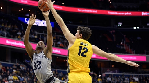 <p>               Georgetown guard Kaleb Johnson (32) goes to the basket against Marquette center Matt Heldt (12) during the second half of an NCAA college basketball game, Tuesday, Jan. 15, 2019, in Washington. Marquette won 74-71. (AP Photo/Nick Wass)             </p>