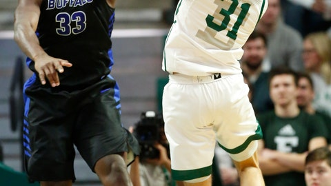 <p>               Eastern Michigan forward Ty Groce (31) tries to take a shot against Buffalo forward Nick Perkins (33) during the first half of an NCAA college basketball game Friday, Jan. 4, 2019, in Ypsilanti, Mich. (AP Photo/Duane Burleson)             </p>