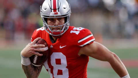 """<p>               FILE - In this Sept. 22, 2018, file photo, Ohio State quarterback Tate Martell runs against Tulane during an NCAA college football game in Columbus, Ohio. Martell says he is transferring from Ohio State to Miami. Martell announced on Twitter early Wednesday, Jan. 16: """"I'm a Hurricane."""" Martell had entered his name into the NCAA transfer portal last week and was free to be approached by schools about a potential transfer. (AP Photo/Jay LaPrete, File)             </p>"""