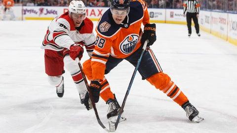 <p>               Carolina Hurricanes' Teuvo Teravainen (86) chases Edmonton Oilers' Jesse Puljujarvi (98) during the second period of an NHL hockey game in Edmonton, Alberta, Sunday, Jan. 20, 2019. (Jason Franson/The Canadian Press via AP)             </p>