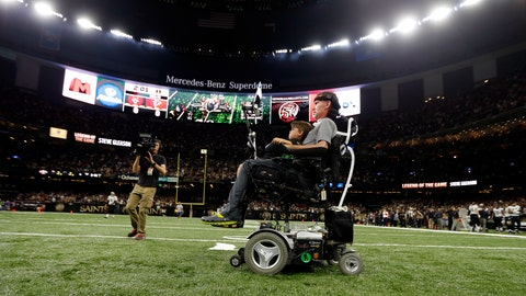 <p>               FILE - In this Sept. 26, 2016, file photo, former New Orleans Saints player Steve Gleason rides onto the field with with his son Rivers before an NFL football game against the Atlanta Falcons in New Orleans. He's the Saints' biggest fan and the perfect symbol of a city that knows a thing or two about overcoming hardship. As the Big Easy goes for another championship, Gleason is along for the ride. Even though his body failed him, perhaps because of the game he loved so much, he never lost the will to live and love and make a difference. (AP Photo/Gerald Herbert, File)             </p>