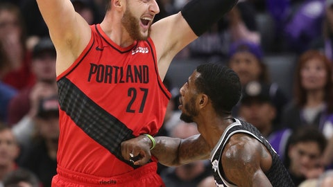 <p>               Portland Trail Blazers center Jusuf Nurkic looks to pass the ball over Sacramento Kings guard Iman Shumpert during the first half of an NBA basketball game Tuesday, Jan. 1, 2019, in Sacramento, Calif. (AP Photo/Rich Pedroncelli)             </p>