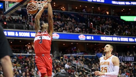 <p>               Washington Wizards guard Bradley Beal (3) dunks past Atlanta Hawks center Alex Len (25) during the second half of an NBA basketball game Wednesday, Jan. 2, 2019, in Washington. The Wizards won 114-98. (AP Photo/Nick Wass)             </p>