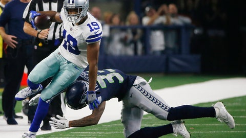 <p>               Dallas Cowboys wide receiver Amari Cooper (19) is hit by Seattle Seahawks free safety Tedric Thompson (33) during the first half of the NFC wild-card NFL football game, in Arlington, Texas, Saturday, Jan. 5, 2019. (AP Photo/Ron Jenkins)             </p>