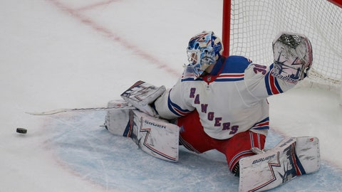 <p>               New York Rangers goaltender Henrik Lundqvist (30) makes a save during the third period of an NHL hockey game against the Boston Bruins, Saturday, Jan. 19, 2019, in Boston. (AP Photo/Mary Schwalm)             </p>