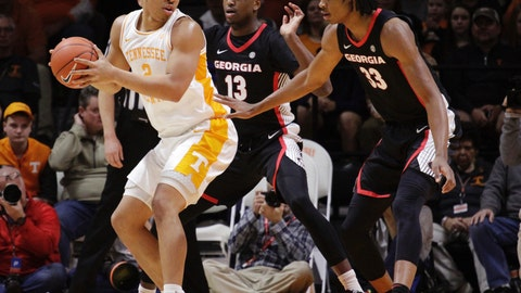 <p>               Tennessee forward Grant Williams (2) looks for the shot while Georgia forward E'Torrion Wildrige (13) and Nicolas Claxton (33) defend in the first half of an NCAA college basketball game Saturday, Jan. 5, 2019, in Knoxville, Tenn. (AP Photo/Shawn Millsaps)             </p>