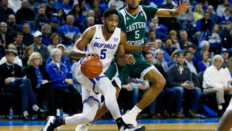 <p>               Buffalo guard CJ Massinburg (5) drives past Eastern Michigan forward Elijah Minnie (5) during the second half of an NCAA college basketball game, Friday, Jan. 18, 2019, in Buffalo N.Y. (AP Photo/Jeffrey T. Barnes)             </p>