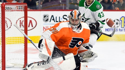 <p>               Philadelphia Flyers goaltender Carter Hart watches the puck after making a save in front of Dallas Stars' Valeri Nichushkin, rear, during the first period of an NHL hockey game Thursday, Jan. 10, 2019, in Philadelphia. (AP Photo/Derik Hamilton)             </p>