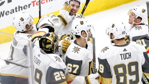 <p>               Vegas Golden Knights defenseman Shea Theodore,top center, celebrates with teammates after his goal against the Chicago Blackhawks during the overtime period of an NHL hockey game Saturday, Jan. 12, 2019, in Chicago. (AP Photo Nuccio DiNuzzo)             </p>