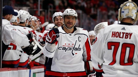 <p>               Washington Capitals left wing Alex Ovechkin greets teammates after Tom Wilson scores on Detroit Red Wings goaltender Jimmy Howard during the first period of an NHL hockey game, Sunday, Jan. 6, 2019, in Detroit. (AP Photo/Carlos Osorio)             </p>