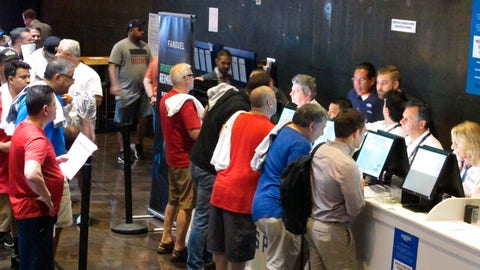 <p>               FILE - This  July 14, 2018 file photo shows gamblers placing bets on sports events at the FanDuel sports book at the Meadowlands Racetrack in East Rutherford, N.J., on the day it opened.  The race to legalize sports betting is on now that the U.S. Supreme Court has allowed it in all 50 states, but will it provide enough extra tax revenue to make much of a difference for schools, roads or pension debt? (AP Photo/Wayne Parry, File)             </p>