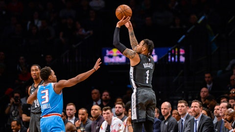 <p>               Brooklyn Nets guard D'Angelo Russell (1) shoots over Sacramento Kings guard Yogi Ferrell (3) during the first half of an NBA Basketball game, Monday, Jan. 21, 2019, in New York. (AP Photo/Howard Simmons)             </p>