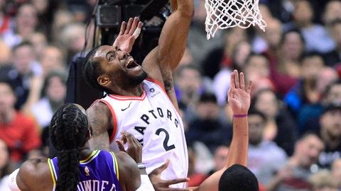 <p>               Toronto Raptors forward Kawhi Leonard (2) is fouled going to the net by Utah Jazz forward Jae Crowder (99) as forward Royce O'Neale (23) watches during the first half of an NBA basketball game Tuesday, Jan. 1, 2019, in Toronto. (Frank Gunn/The Canadian Press via AP)             </p>