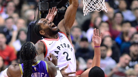 <p>               Toronto Raptors forward Kawhi Leonard (2) is fouled going to the net by Utah Jazz forward Jae Crowder (99) as forward Royce O'Neale (23) watches during the first half of an NBA basketball game Tuesday, Jan. 1, 2019, in Toronto. (Frank Gunn/The Canadian Press via AP)             </p>