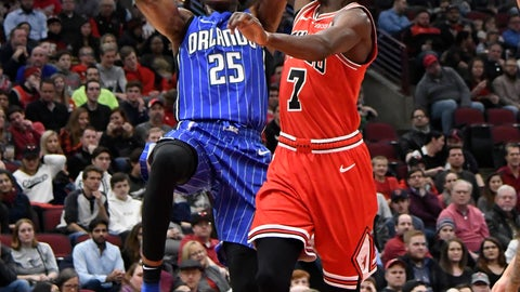 <p>               Orlando Magic forward Wesley Iwundu (25) goes to the basket as Chicago Bulls forward Justin Holiday (7) defends him during the first half of an NBA basketball game Wednesday, Jan. 2, 2019 in Chicago. (AP Photo/David Banks)             </p>
