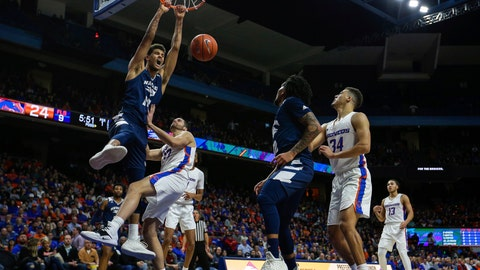 <p>               Nevada forward Trey Porter (15) dunks the ball over Boise State forward David Wacker (33) during the first half of an NCAA college basketball game, Tuesday, Jan. 15, 2019, in Boise, Idaho. (AP Photo/Steve Conner)             </p>